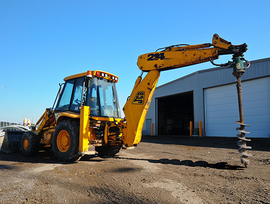 Back Hoe Auger | Full Stack Excavation & Equipment Rental Services